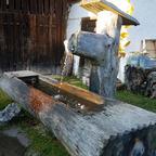 Wasserspeier in den Bergen - Holz